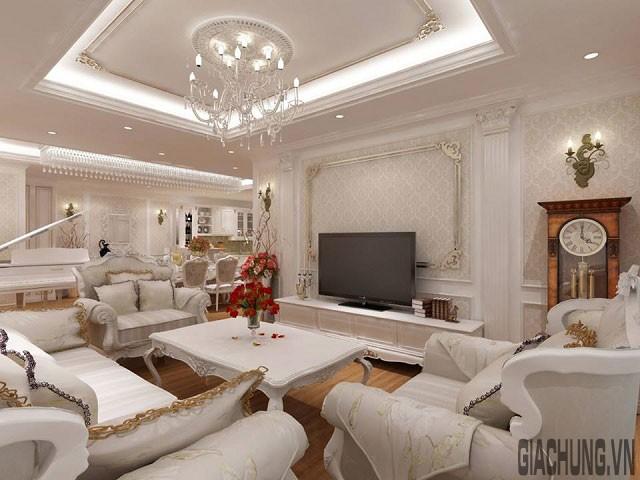 Phòng khách được trang trí ấn tượng bằng khung phào cầu kỳ màu ánh kim sang trọng.